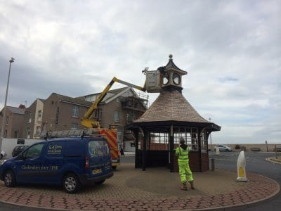 Removing the clock faces from the shelter for restoration, Save our Clock Shelter Campaign