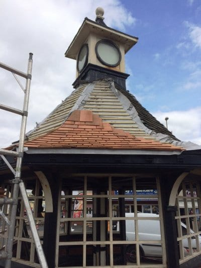 New shingles going on the clock shelter roof, Save our Clock Shelter Campaign