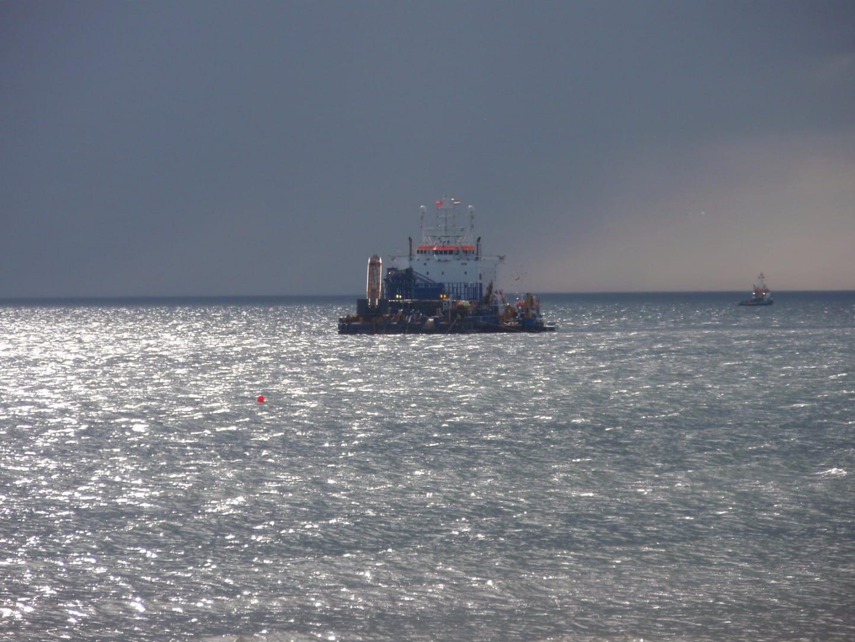 Stemat Spirit cable barge leaving shore