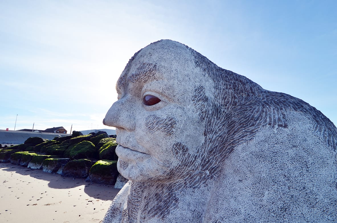 Stone Ogre on Cleveleys beach, artwork from the Mythic Coast on Cleveleys Seafront